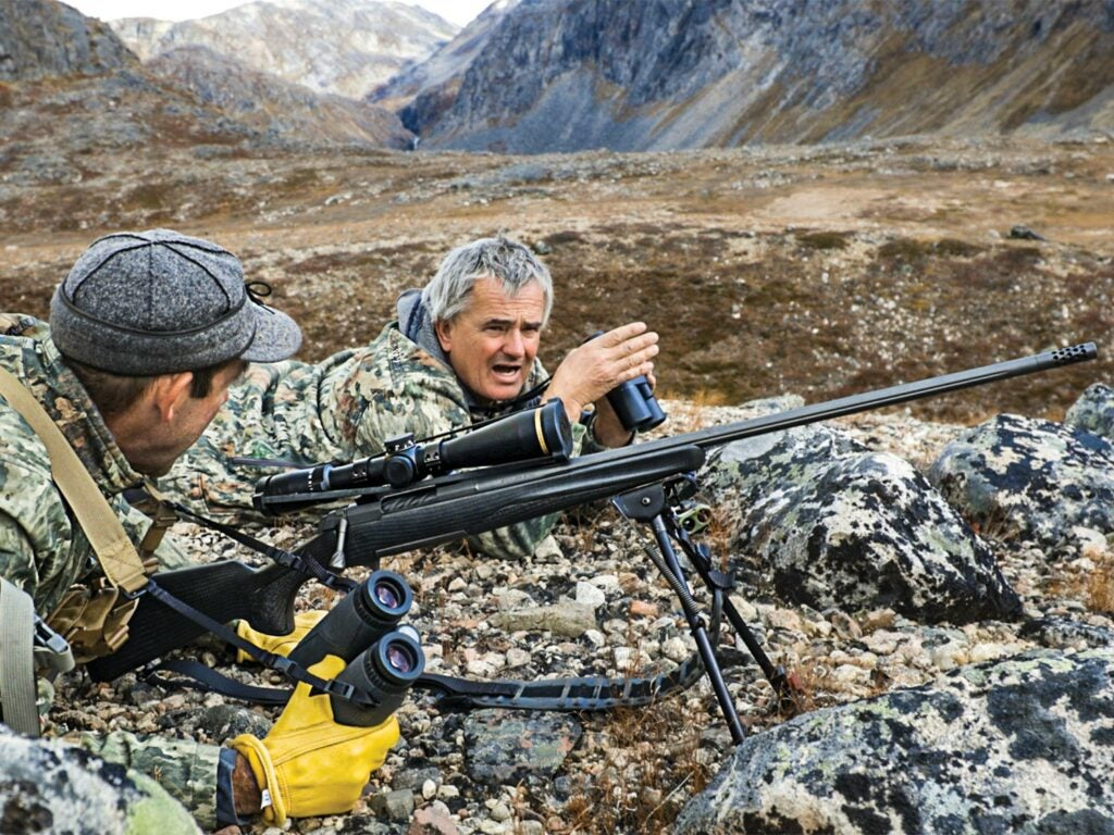 Frank Feldmann and the author set up for a long shot at grazing musk ox.