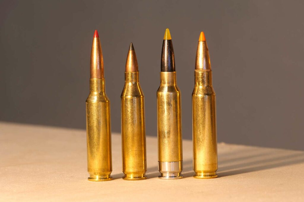 A lineup of 4 rifle ammo cartridges.