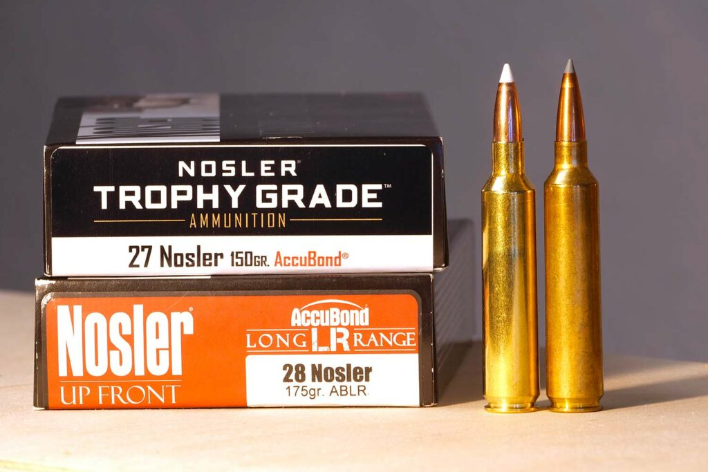 Two boxes of nosler rifle ammo.