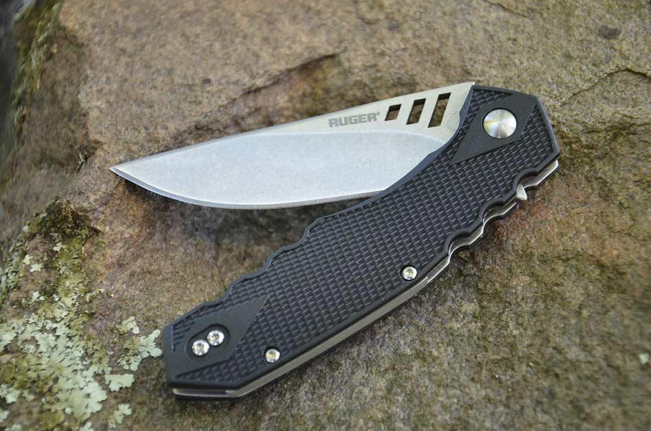 A folding knife on a rock.
