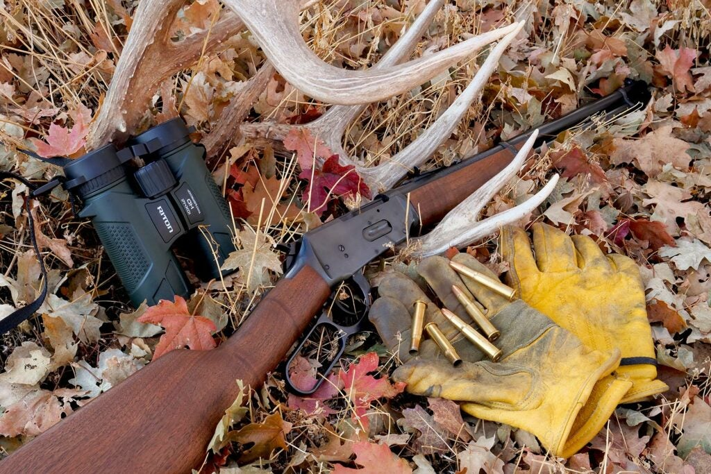 Hunting gear and a .30-.30 lever-action brush rifle.