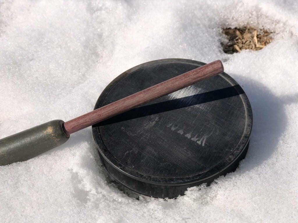 Aluminum pot call in the snow.
