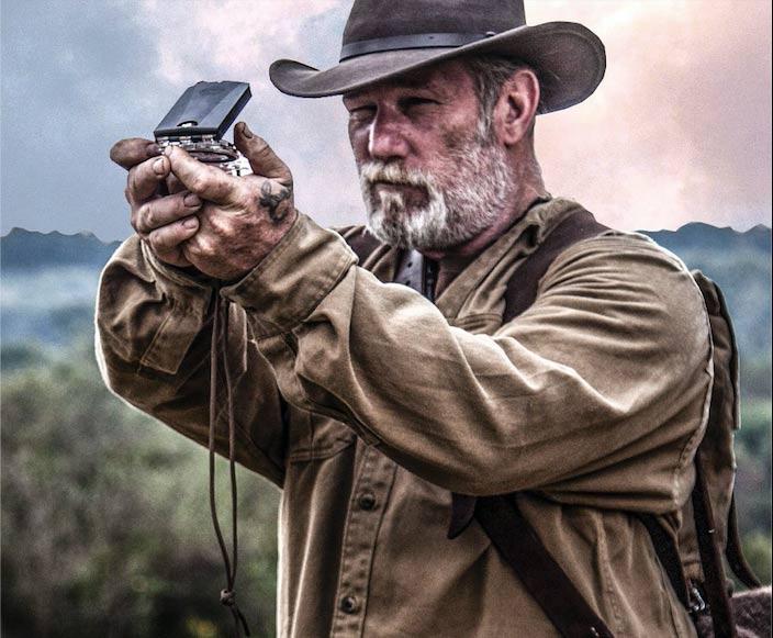 Man holding a compass.