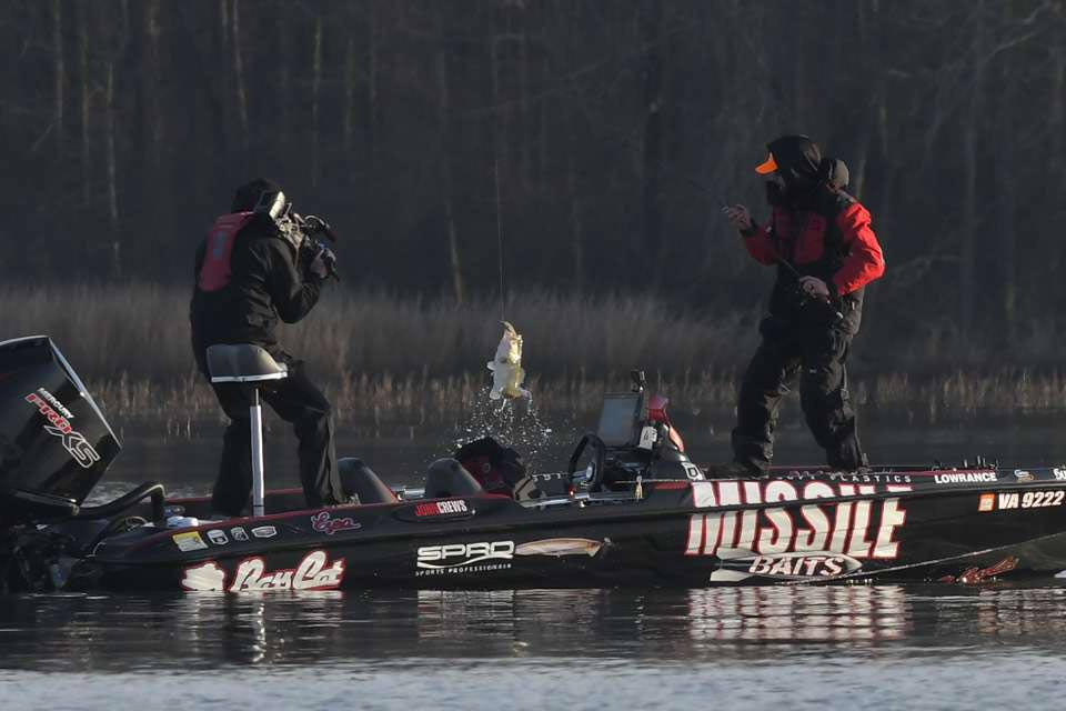 John Crews fishing on a bass boat.