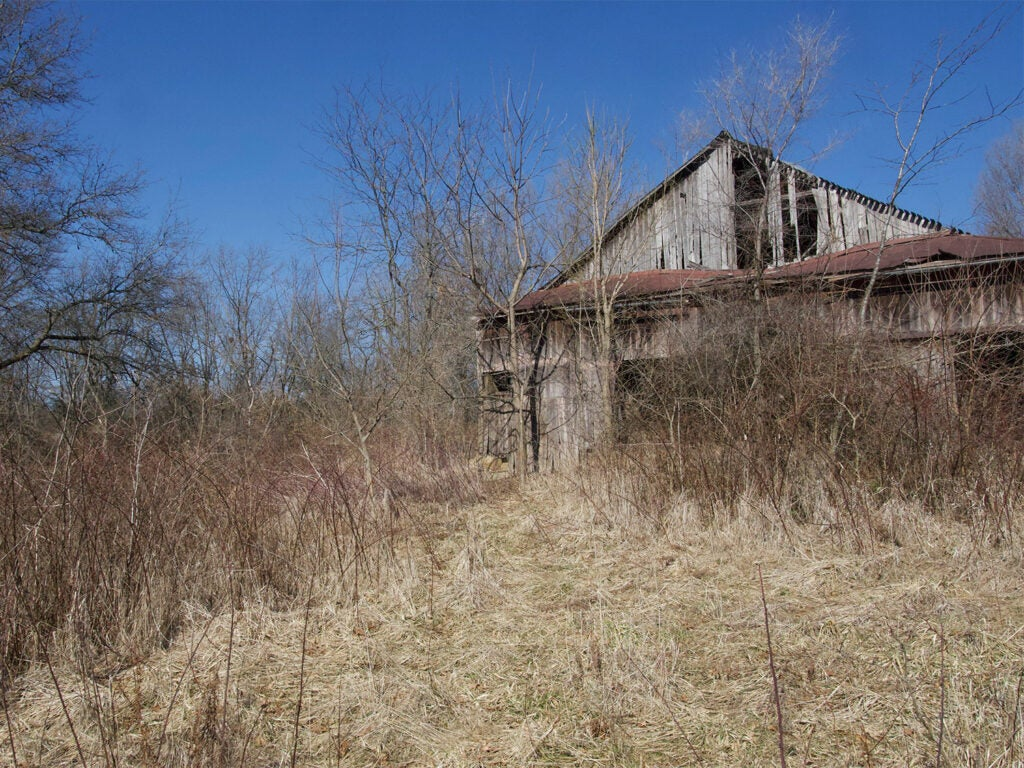 An abandoned dilapidated barn.