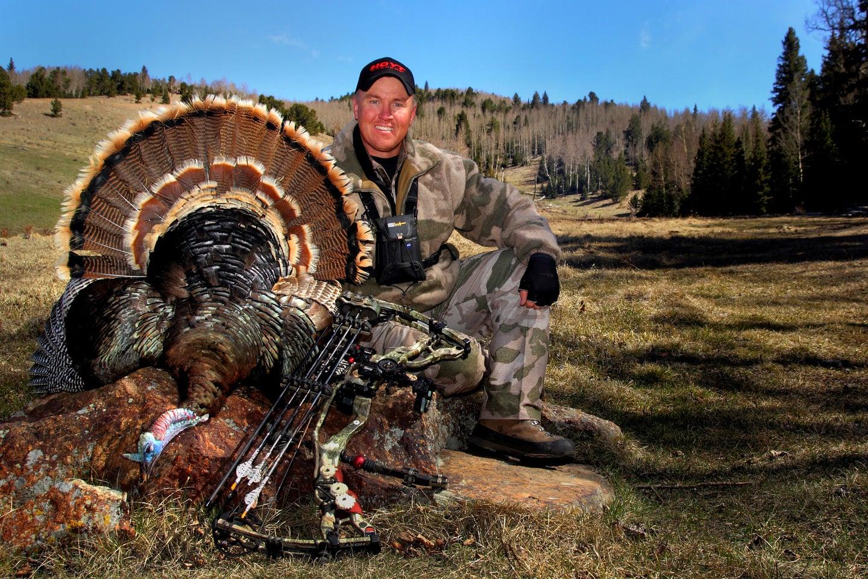 Hunter with a merriam turkey.