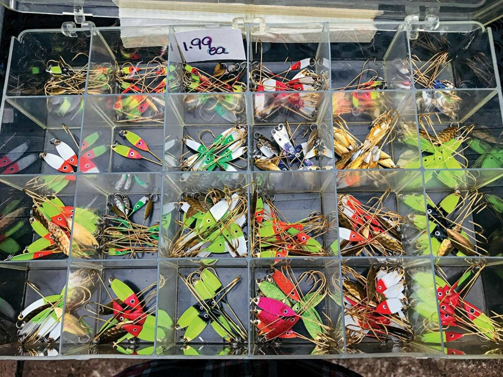 A box of hand-painted flutter spoon lures.