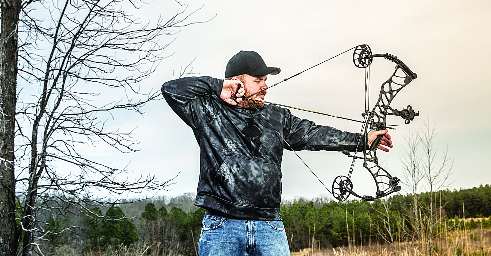 Bowhunter drawing back on a compound bow.