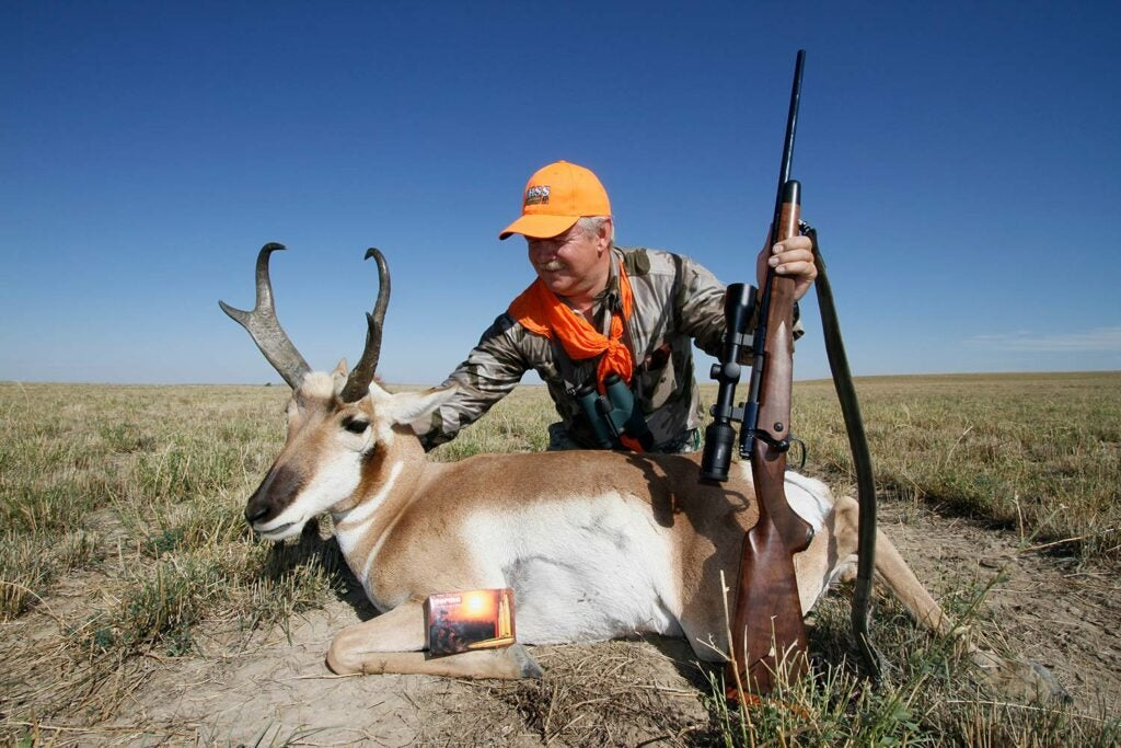 Antelope hunter in a field.