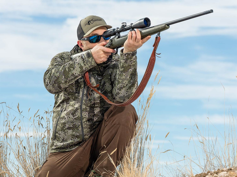 Man aiming a rifle.