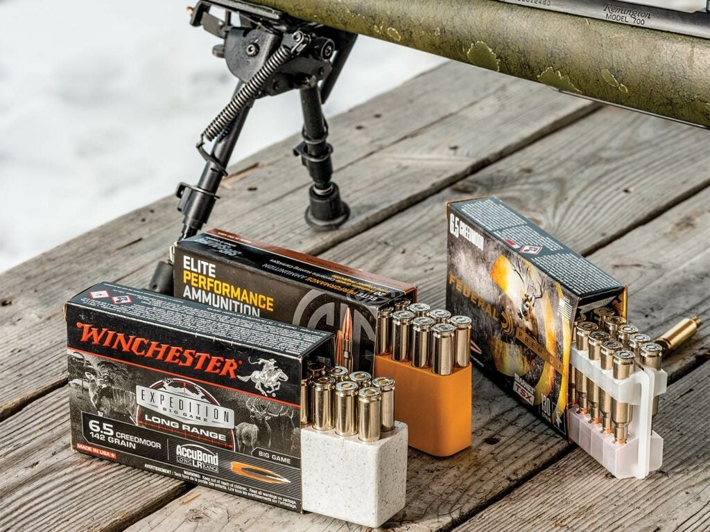 A rifle and three sets of hunting ammo.