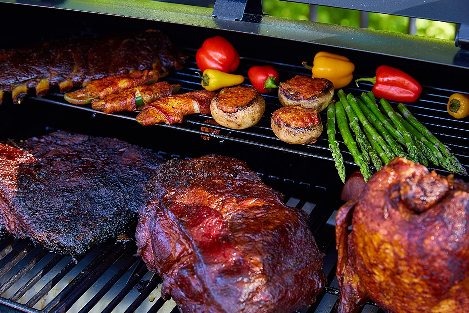 meat and veggies on a grill.