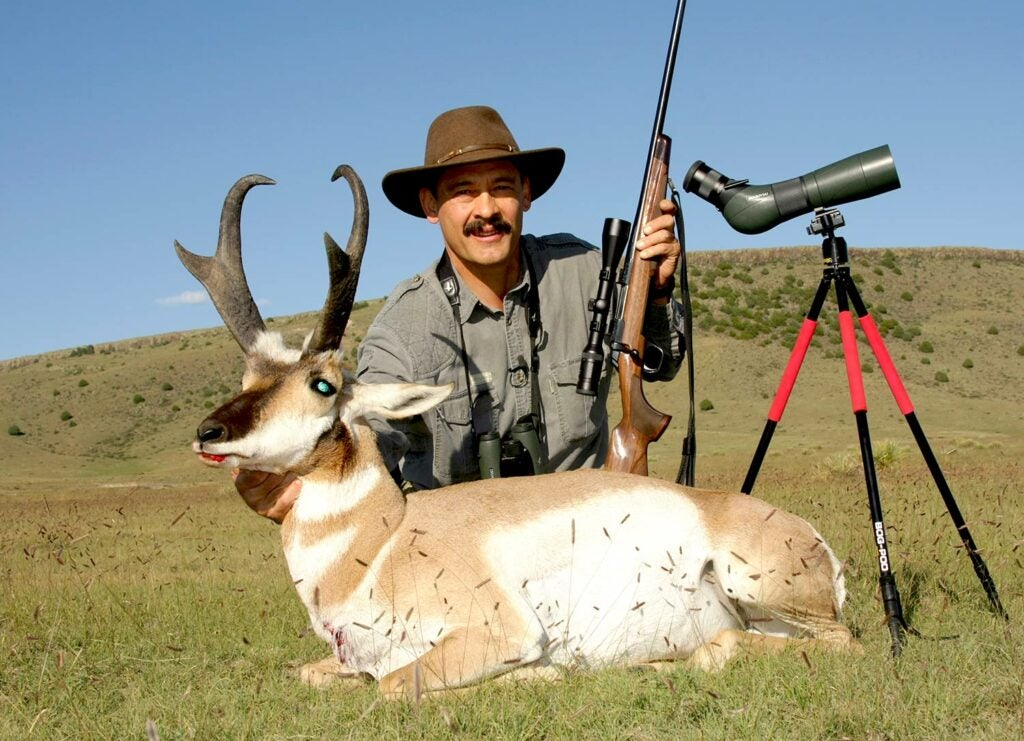 Hunter next to an antelope.