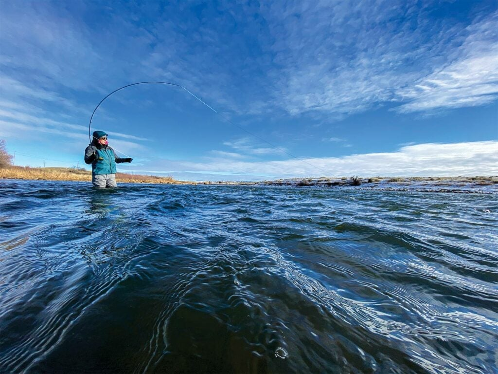 Female angler fishing in Wyoming's North Platte River.