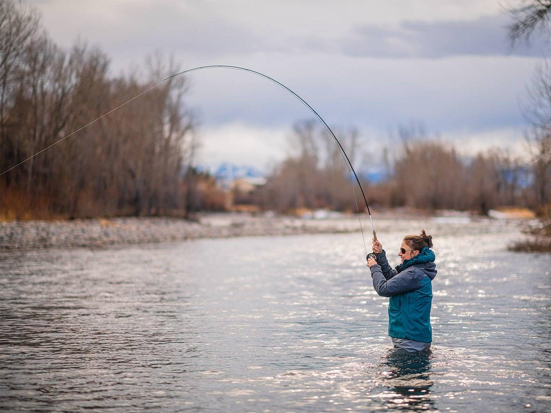 Female angler fishing in the Montana Boulder River.