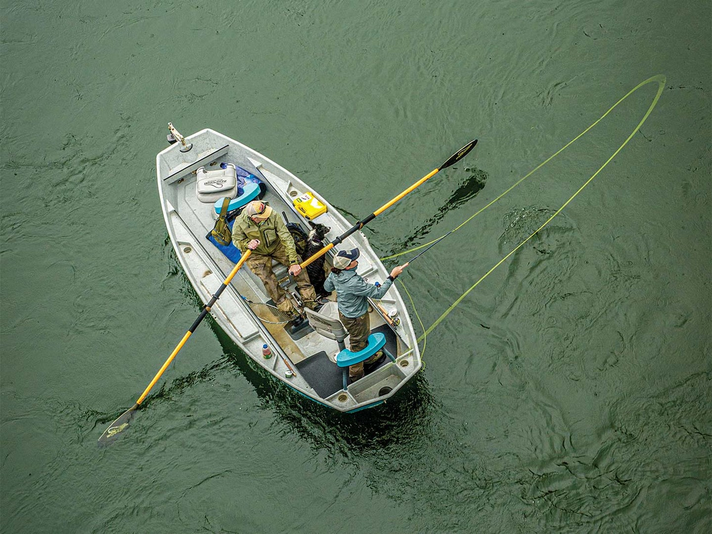 Two anglers in a row boat