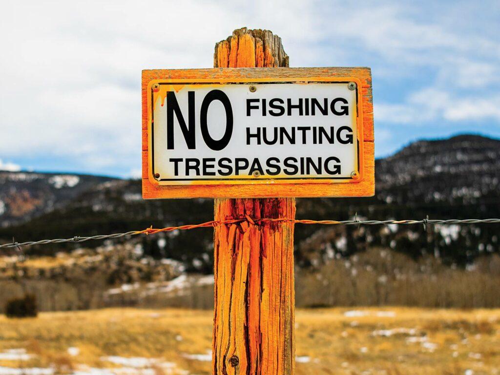 No Fishing, Hunting or Trespassing sign.