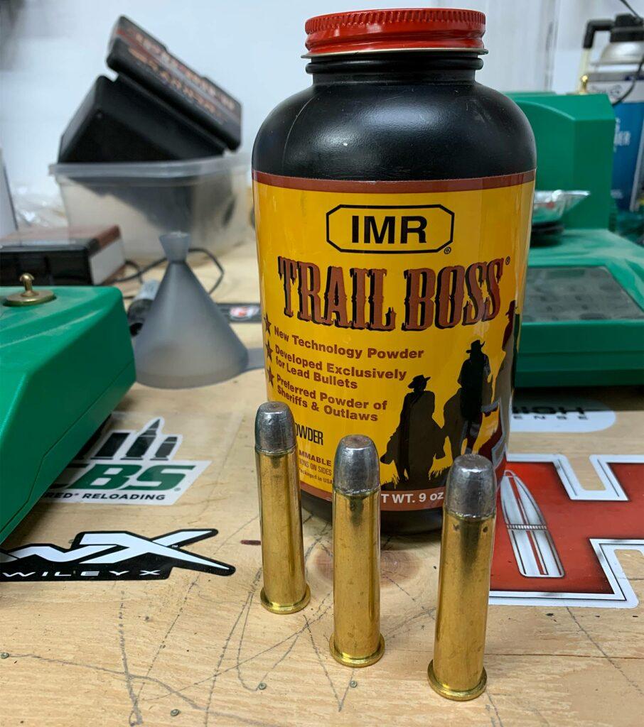 Trail boss gunpowder and handloaded rounds.