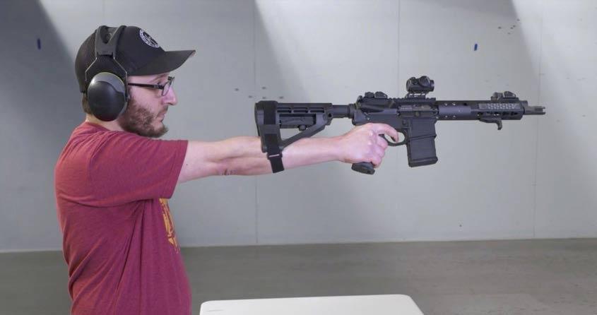 Man aiming SB tactical pistol