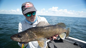 Steven Pennaz holding up a large walleye.