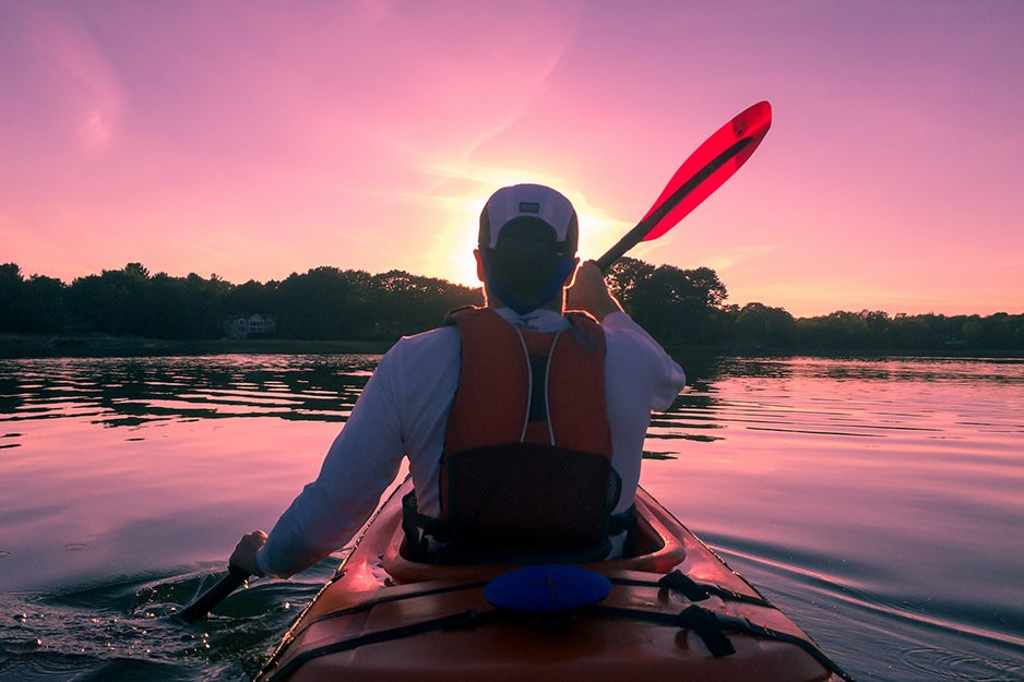 man in a kayak with life vest
