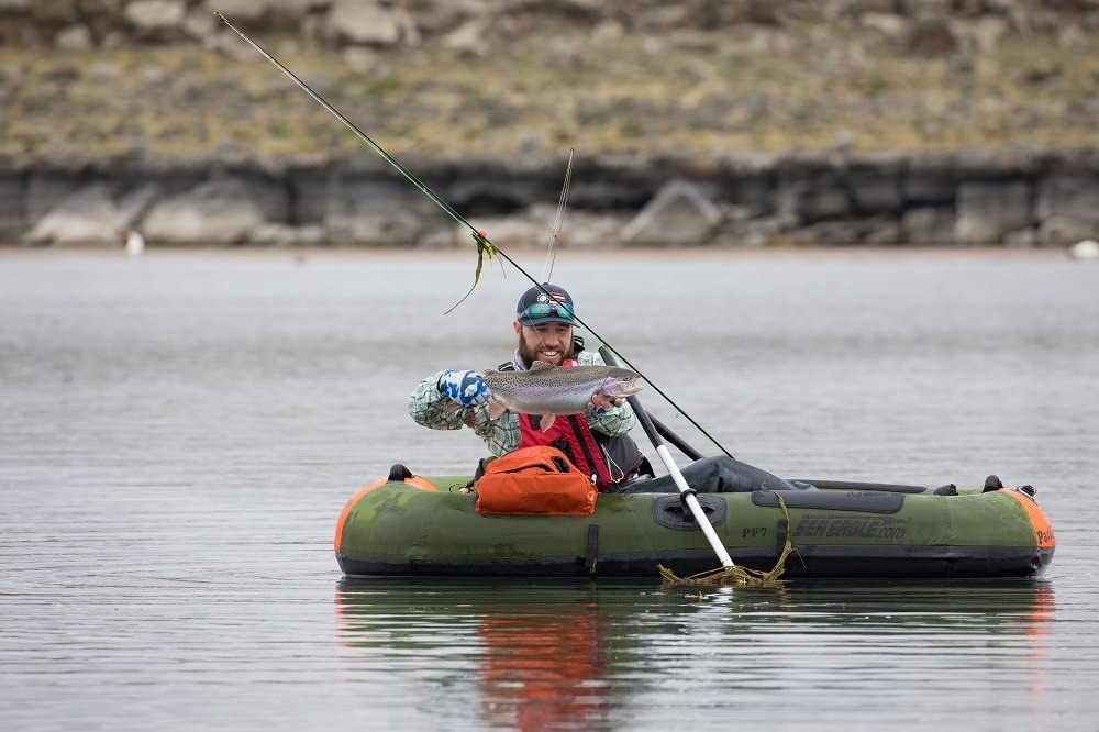 man fishing in an inflatable boat