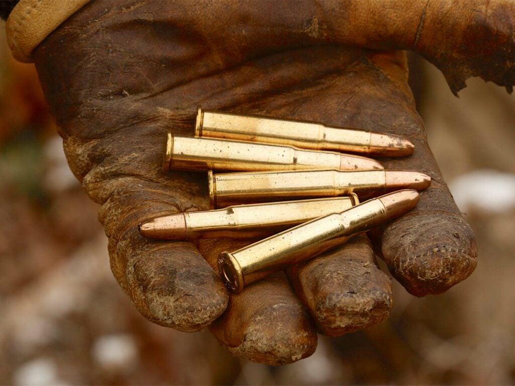 A handful of rifle ammo.