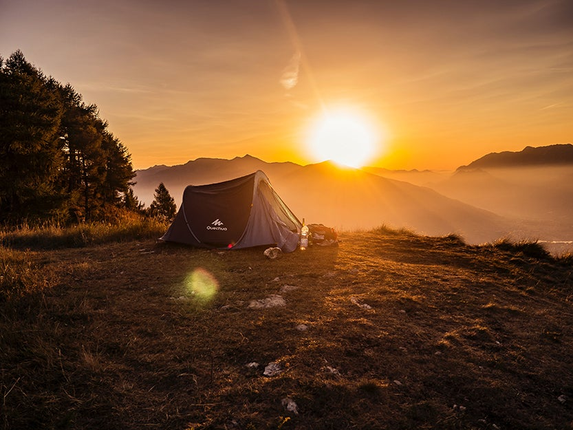 tent in front of a sunset