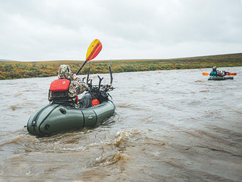 Hunters floating on the Sagavanirktok river.