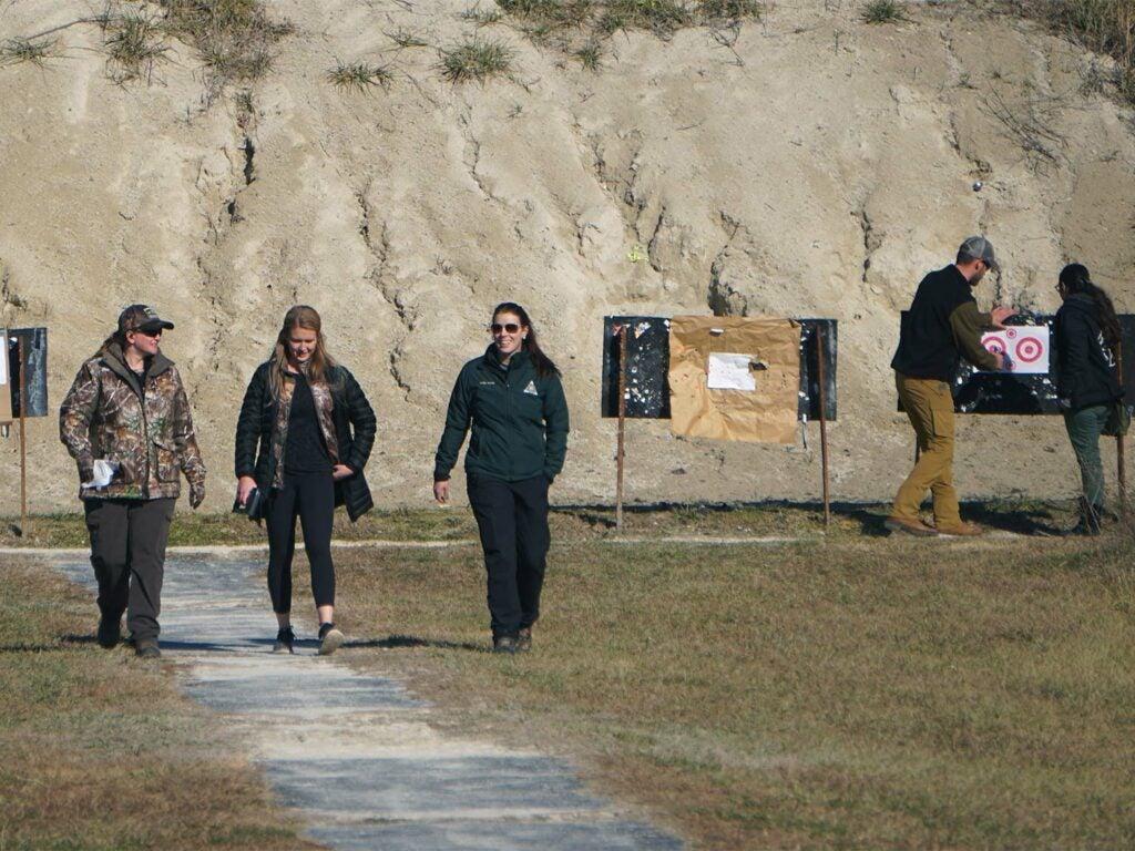 Women walking at a gun range.