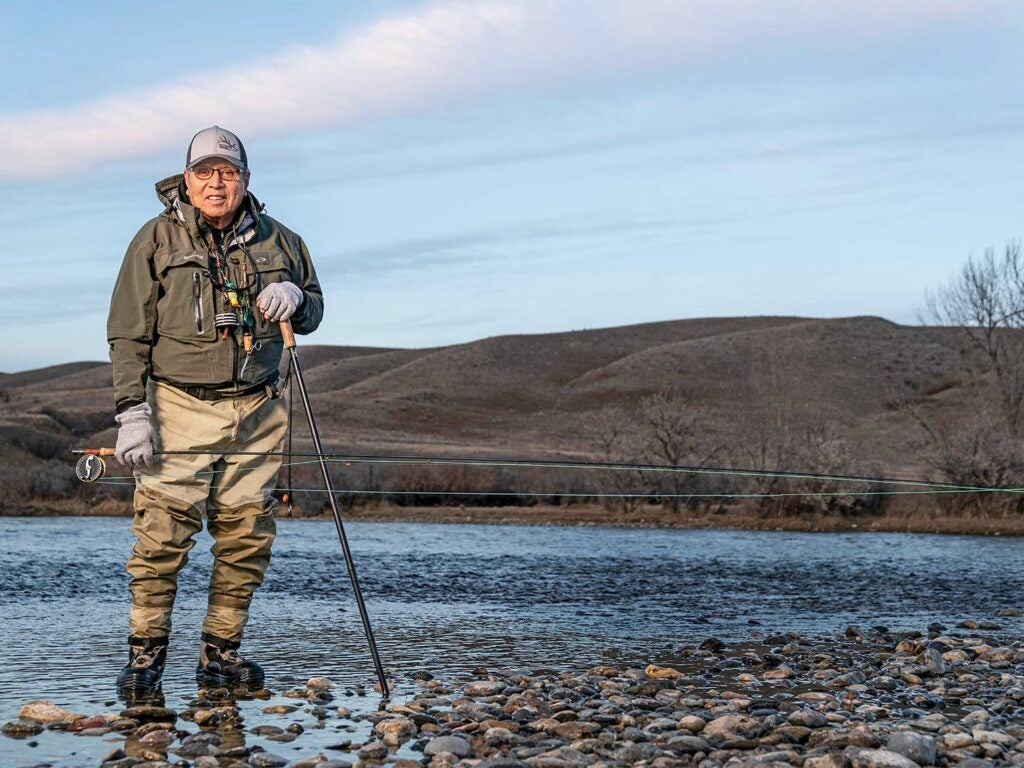 Phil Gonzalez standing on the Bighorn River in Montana.