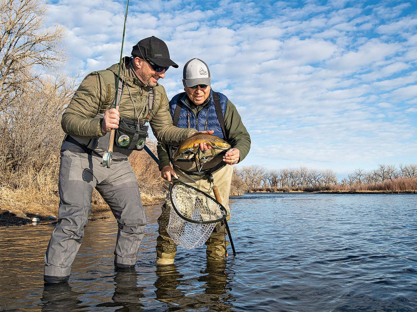 Two anglers fishing trout in Montana's Bighorn River.