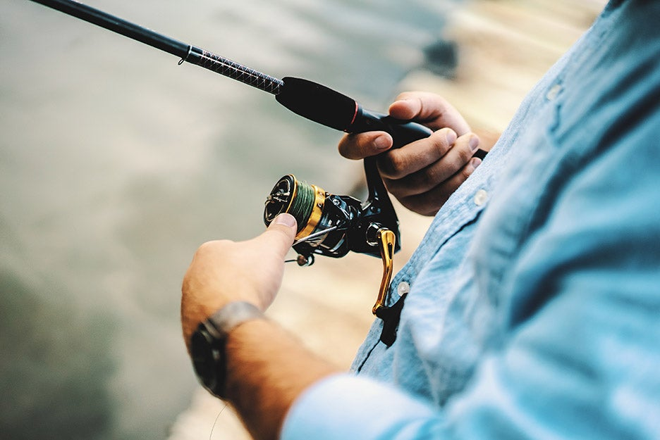 person holding a fishing rod