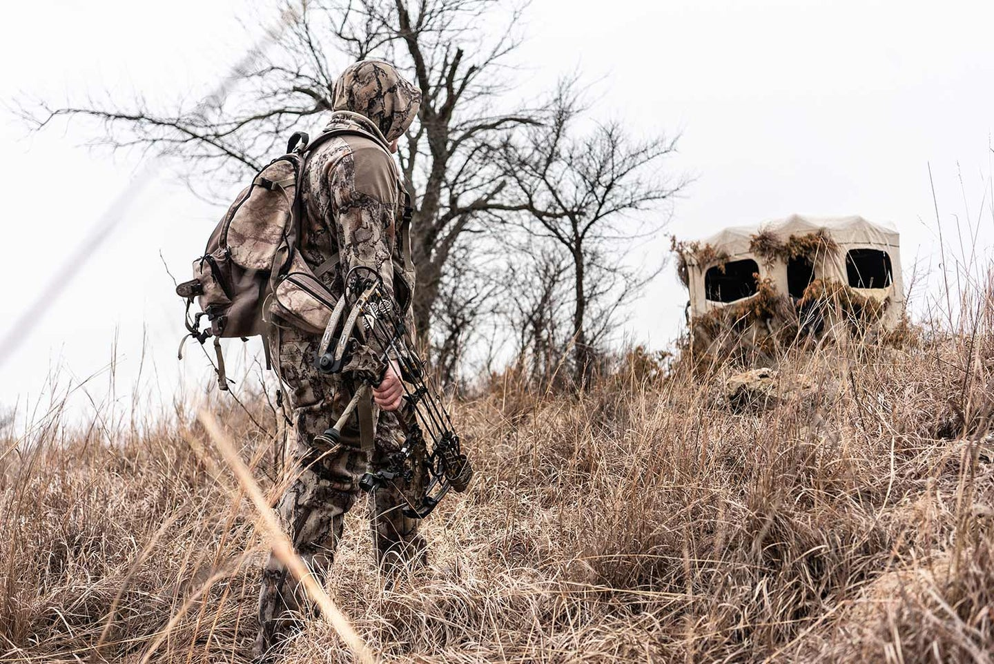 Hunter walking to a hunting blind.