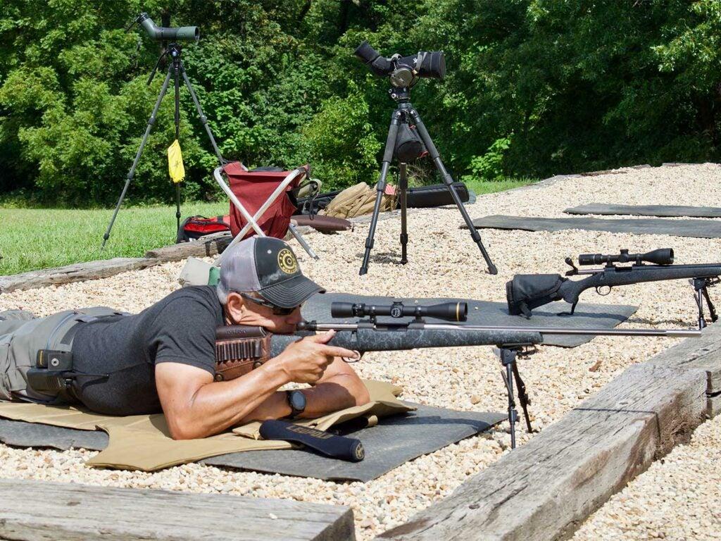 Jim Kauber aiming a rifle.