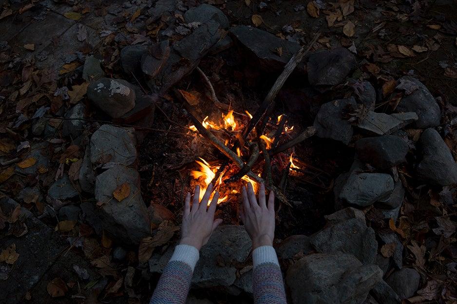 hands over a fire