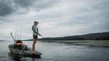 An angler on the bow of a kayak.