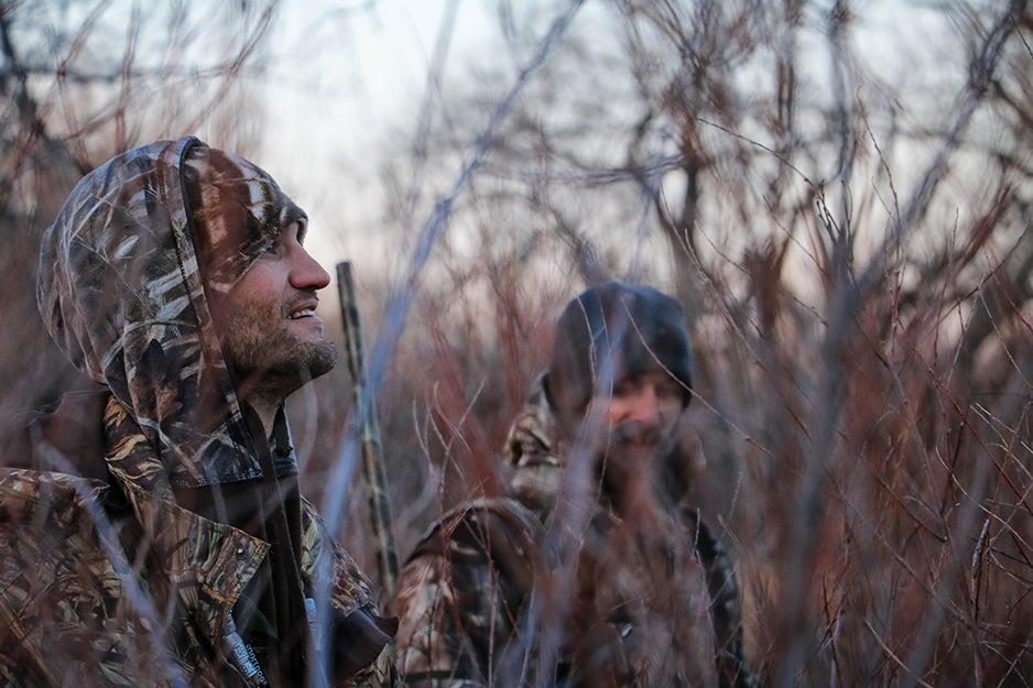 hunters in field