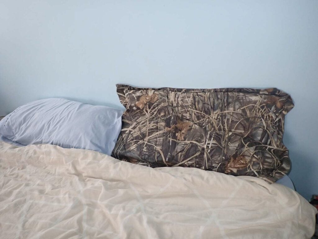 A camoflauge pillow case stuffed with waterfowl down.