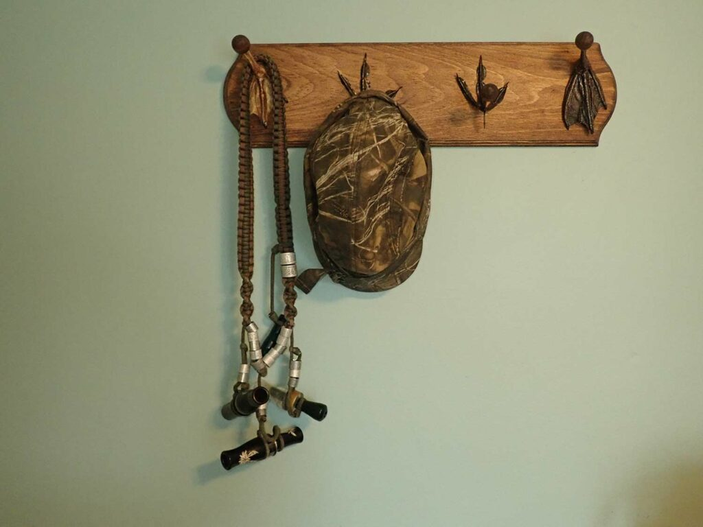 A wall-hanging hat rack made with duck feet.