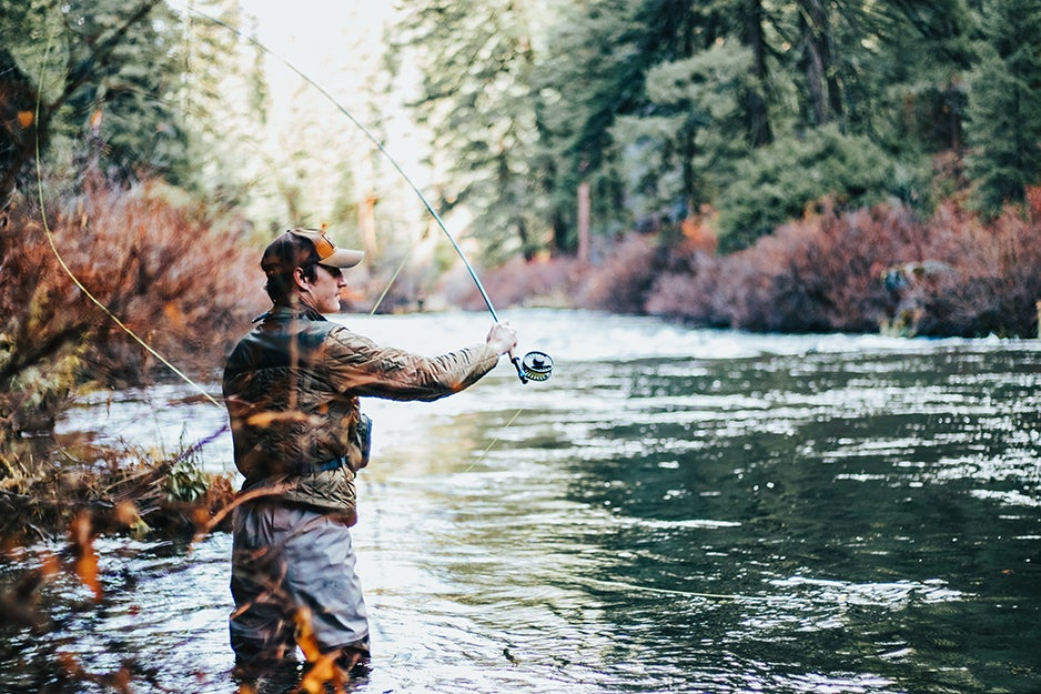 guy fishing in stream
