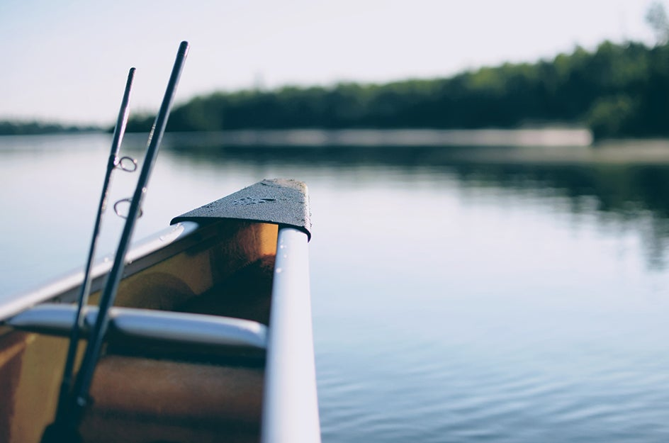 boat in water with fishing rod