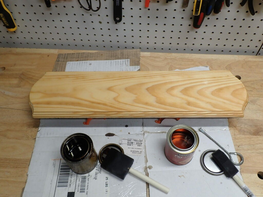 Wooden plaque and finishing solvents.