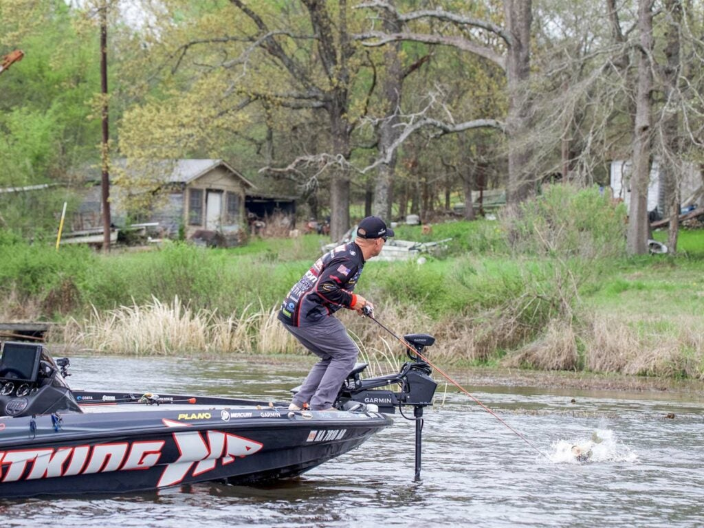 Angler Brent Chapman fishing off the front of a boat.