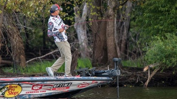 Edwin Evers fishing off the front of a Bass Pro sport fishing boat.