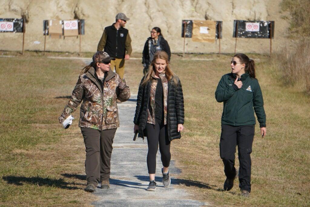 women retrieving targets at a public shooting range in missouri