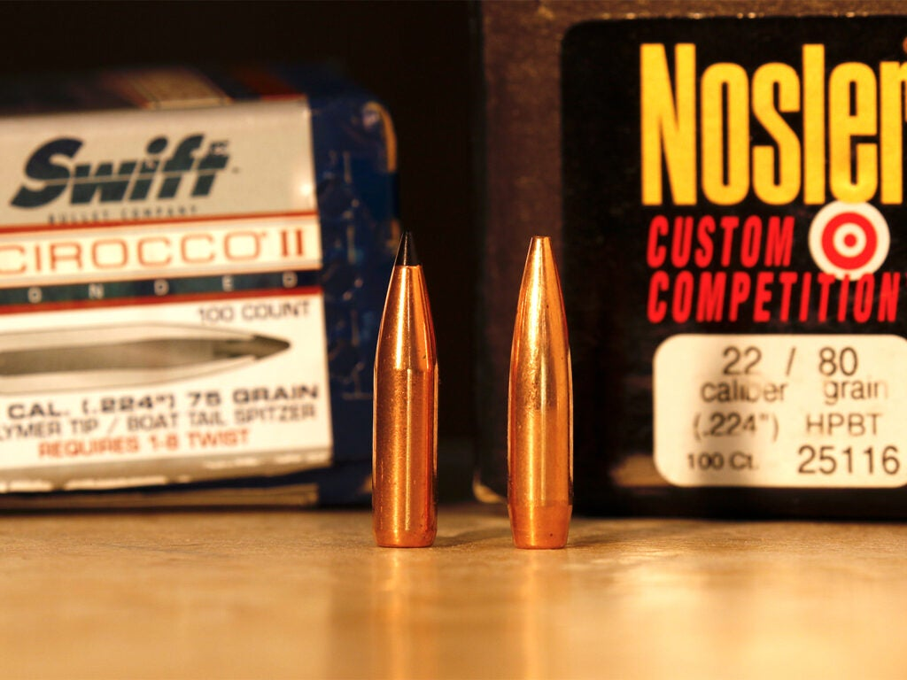Two different rifle bullets side by side with manufacturing boxes.