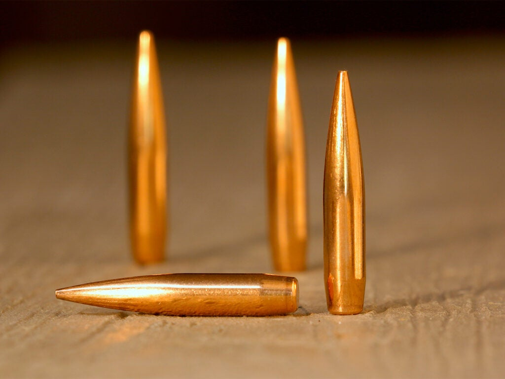 Several rifle bullets on a table.