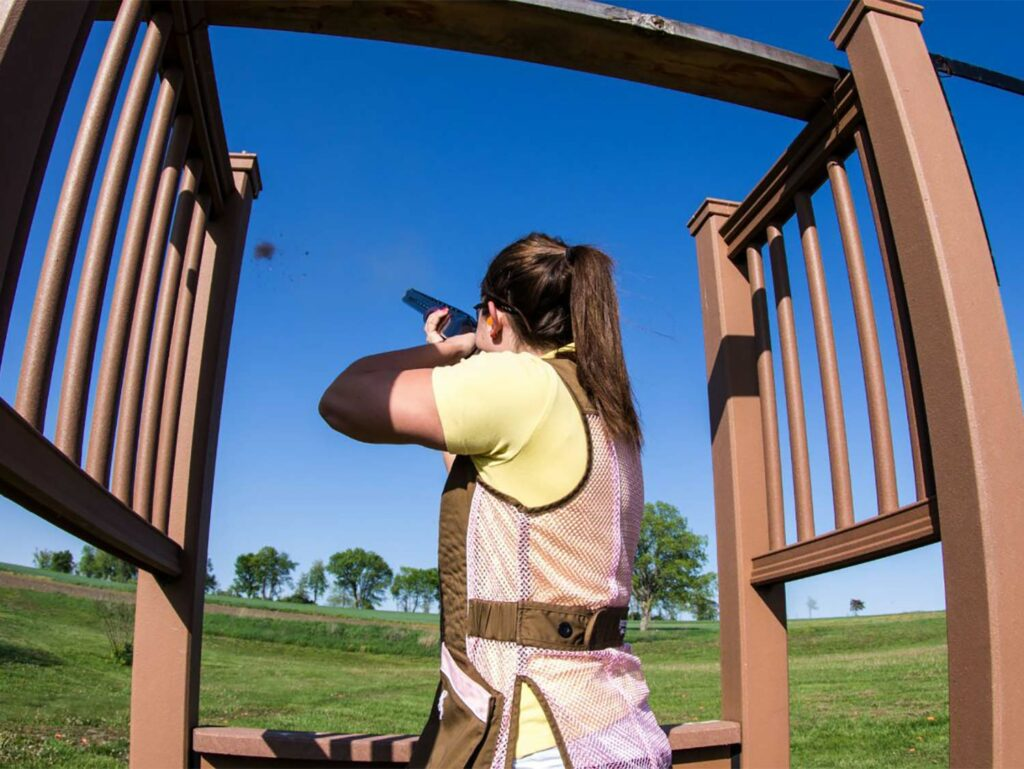 A woman shooter at a range while shooting skeet.