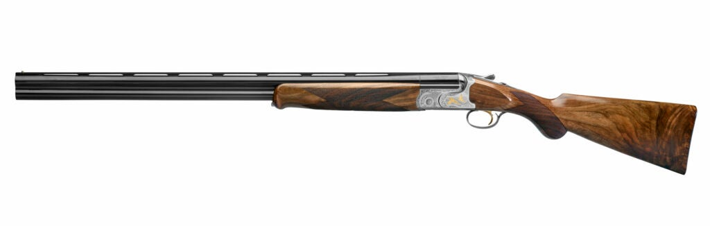 double barrel over/under shotgun with wood stock and metallic receiver